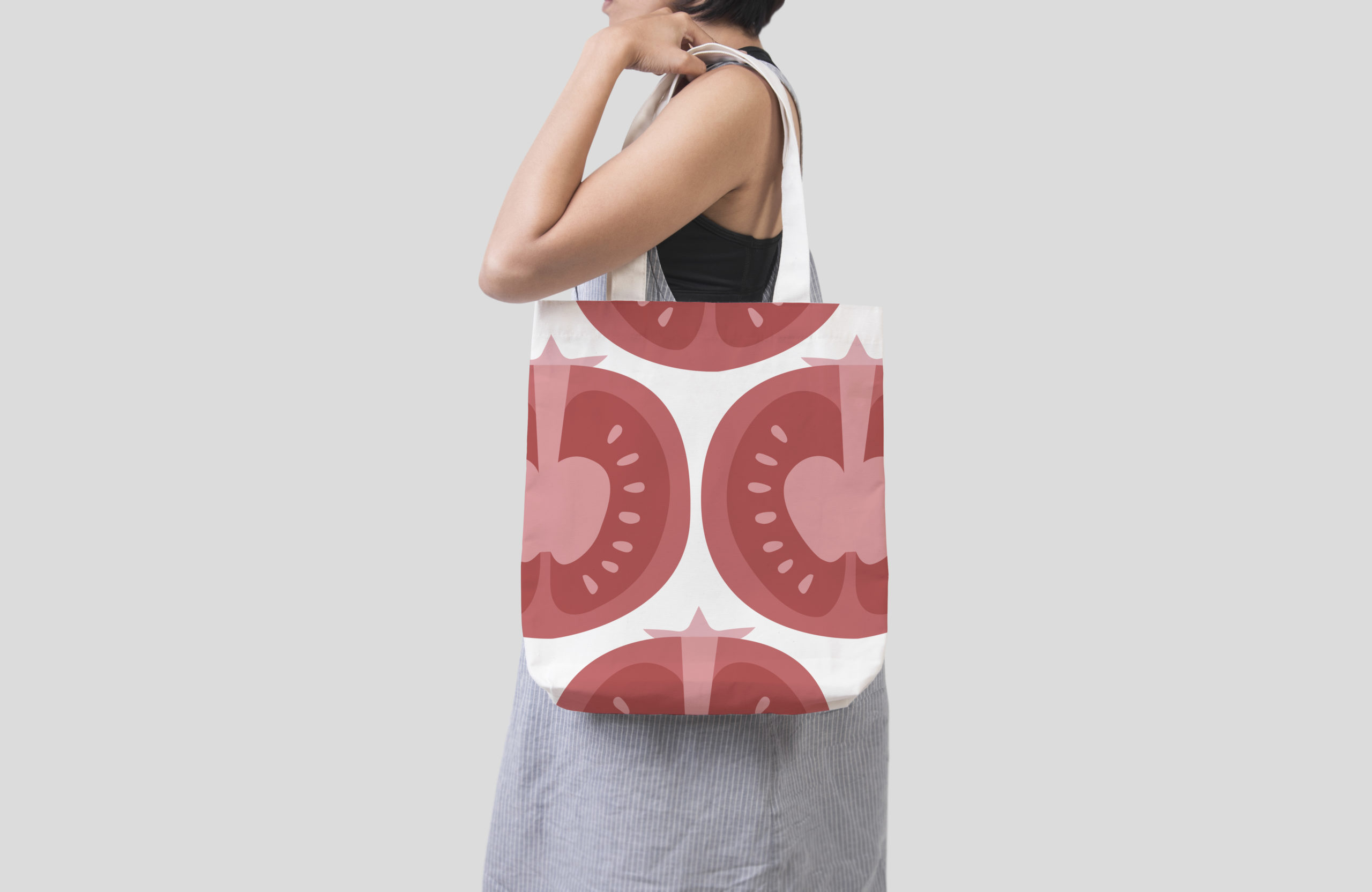 Girl is holding bag canvas fabric for mockup blank template isol
